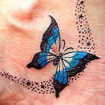 Stardust and butterfly tattoo on foot
