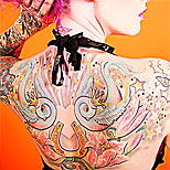 Woman with a swallows tattoo on her back