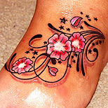 Swirly flower tattoo on foot