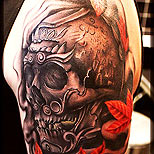 Tibetan skull on a man's arm