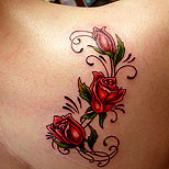 Tribal roses tattoo on a girl's shoulder