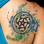 Tribal star tattoo design on a woman's shoulder