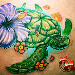 Turtle and hibiscus tattoo