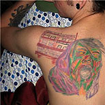 Very ugly tattoos on a man's back