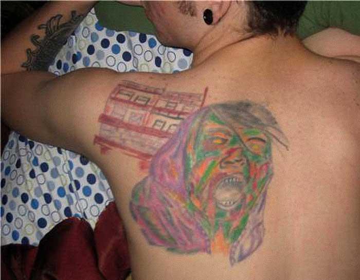 25eba2ac8 ... Very ugly tattoos on a man's back. Horrible Jesus tattoo, Really Bad ...