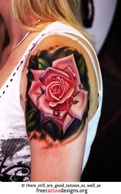 12fc2297d0050 ... Unique rose tattoo on a woman's upper arm