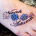 Violet and names tattoo on foot