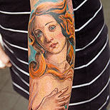 Virgo tattoo on a man's arm