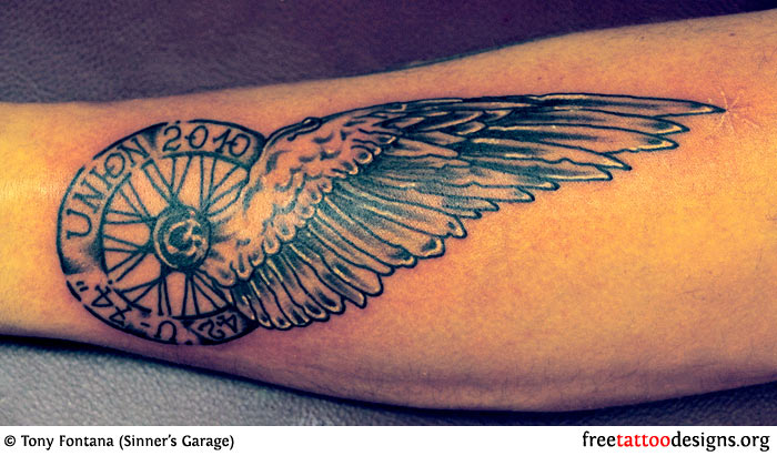 Wheel and Wing Tattoo