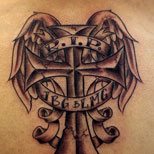 Winged cross tattoo with banner