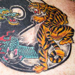 Yin yang dragon and tiger tattoo